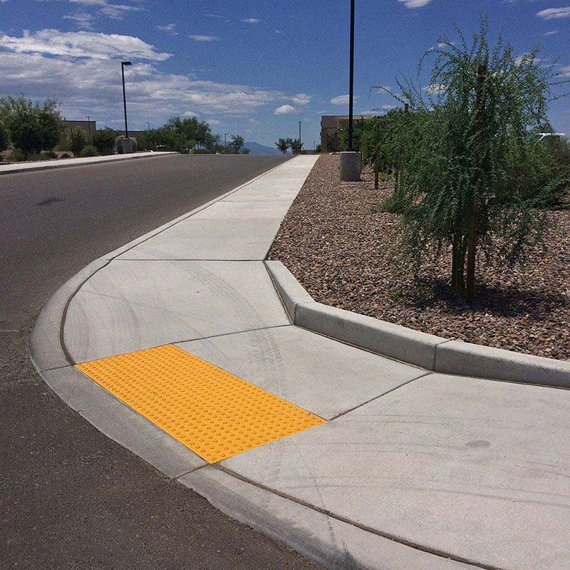 Doulos Concrete Sidewalk Curb and Handicap Ramp